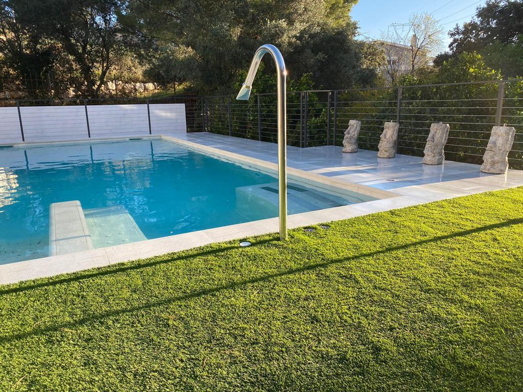 construcción de piscina con jacuzzi y cañon cervilaes ROSA GRES 2